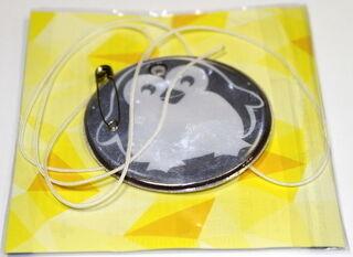 Pyöreä heijastin pakkauksessa pingviini